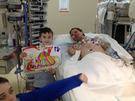 Ben showing Matthew his artwork from school. Afternoon visits to ICU and then rehab were part of the routine for nine months.