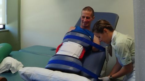 Jacqui (Wright, Matthew's physiotherapist) gets Matthew ready to test pressure on his stumps for the first time.